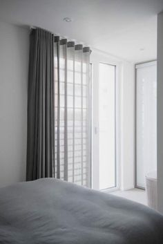 Heavy voile Wave curtains hung on Silent Gliss 3840 ceiling fixed track