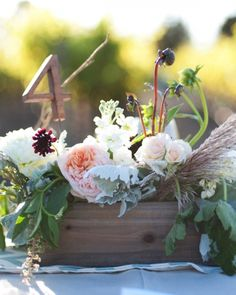 Table numbers from @Etsy were placed inside each centerpiece