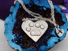A personal favourite from my Etsy shop https://www.etsy.com/uk/listing/465088257/fine-silver-raised-pawprint-necklace