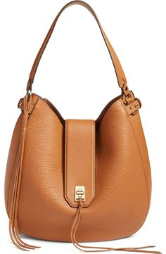 Crafted from soft pebbled leather, this wardrobe staple by Rebecca Minkoff…