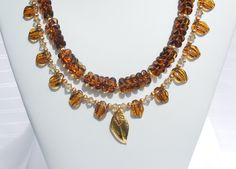 Tortoise shell glass, Swarovski crystal, and gold 2-strand necklace by ParkhillDesigns on Etsy