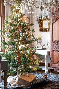 """The back parlor is ready for Christmas. Candlelight is aglow on the antique """"Jenkins"""" piano. A gorgeous faux cedar garla. French Christmas Tree, French Country Christmas, Country Christmas Decorations, Cottage Christmas, Old World Christmas, French Country Cottage, French Country Style, Xmas Decorations, Christmas Home"""