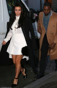 Busting out: Pregnant Kim Kardashian's blouse was gaping around the bust area as she stepped out with boyfriend Kanye West in Paris on Friday