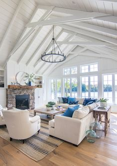 Home Renovation Living Room Lake House Living room blue and white decor - navy and french blue pillows. White planked lake house living room with blue and white decor. Stone fireplace with rustic beam mantel. Coastal Living Rooms, Home Living Room, Living Room Designs, Living Spaces, Cottage Living, Coastal Cottage, Kitchen And Living Room Design, Coastal Decor, Living Room With Color