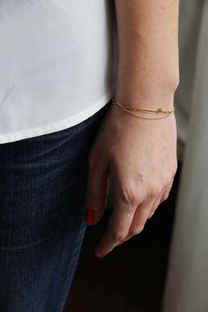 Image of Bracelet chaînes dorées et lien camel.