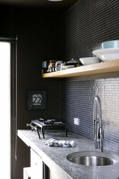 Black tile kitchen. No photographer credit