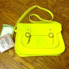 Crossbody bag Yellow crossbody bag with adjustable straps. Magnetic button closure with striped black and white interior. 2 interior pockets and one zippered pocket. There's also one exterior pocket. Silver hardware and vegan leather bag.  Good condition normal wear from use. Brand is called e hyphen world gallery made in Japan. E hyphen world gallery Bags Crossbody Bags