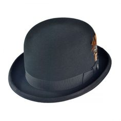 Derby usually black they are also knows as bowl hats they are round a the  top. villagehatshop.com d705668d0fe