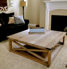 In love with this coffee table. I think I would love it even more stained darker!