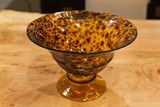 http://www.luxehomephiladelphia.com/products/tortoise-pedestal-bowl-lazy-susan-usa The Tortoise Pedestal Bowl is a chic and functional work of art. Handcrafted from glass, this pedestal bowl features a brown tortoise shell pattern that compliments any table or shelf. The Tortoise Pedestal Bowl is one of many outstanding pieces by Lazy Susan USA offered at Luxe Home Philadelphia.