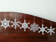 These new beautiful lace white snowflake ornaments are the best to decorate Christmas tree, wall hanging or as baby mobile parts. One set includes 6