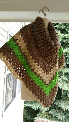 What's Currently On My Hook? I started this cowl-neck poncho Thursday evening. So far I've used Redheart Super Saver in Cafe Latte, Buff, and Spring Green. For the cowl portion, I used an L crochet hook for the cowl for a loose fit. I'm currently using a K crochet hook for the poncho portion! Now back to my regularly scheduled day