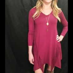 Burgundy Fringed Tunic Dress Absolutely gorgeous on ! One of Southern Lush's Top Sellers! Burgundy, long sleeved V-Neck Tunic dress! Model is wearing the S. 95% Rayon 5% Spandex. Available in S M L! Boutique Dresses Long Sleeve