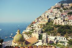 The best things to do in Positano Italy from views off Hotel Sirenuse to Da Adolfo for lunch to Pasquale Volpe painting watercolors on the beach.