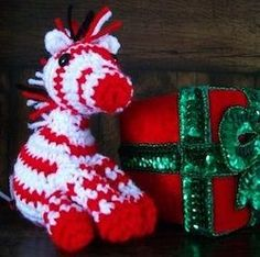 Nothing says Christmas like red and white peppermint candy canes! Here is a little Zebra who ate WAY too much peppermint candy and change. Christmas Crochet Patterns, Holiday Crochet, Crochet Toys Patterns, Amigurumi Patterns, Stuffed Toys Patterns, Christmas Knitting, Crochet Designs, Crochet Gratis, Free Crochet