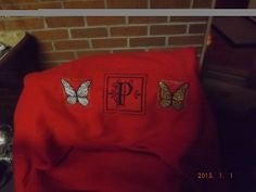 A throw I made for Christmas present. My embroidery machine got a good work out. Not prefect but nice