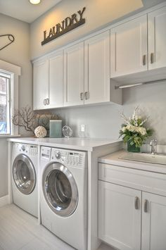 I would love to have an organized laundry room like this some day. Love the cabinets for Laundry storage, and the area above laundry machines, much more usable!! :)