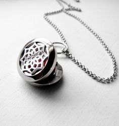 Small round stainless steel locket specially designed for perfume or essential oils. The magnetic locket measures .75 inches (20mm) across and comes on a 23 inch stainless steel chain which features a lobster clasp securing the locket to the chain. This allows you to remove the locket from the chain and easily refill the felt pad whenever you chose. Included in the locket is one felt pad that you put a few drops of your favorite oil on and be able to enjoy the benefits of it all day long…