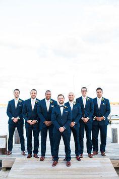 Navy blue groom + groomsmen outfit idea - groom in a navy blue suit with navy blue bowtie + groomsmen in navy blue suits with white bowties {Ashley Tilton Photography}