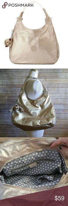 Kipling champagne gold metallic should bag Great condition! This bag is fabulous and has three large pockets! Polka dot interior. Small pockets and key clasp. And Kiplings famous key chain :) Kipling Bags Shoulder Bags