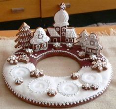 Incredibly beautiful gingerbread town with candles. An Advent wreath gingerbread… Christmas Gingerbread House, Christmas Sweets, Christmas Cooking, Noel Christmas, Christmas Goodies, Gingerbread Cookies, Christmas Decorations, Gingerbread Houses, Xmas