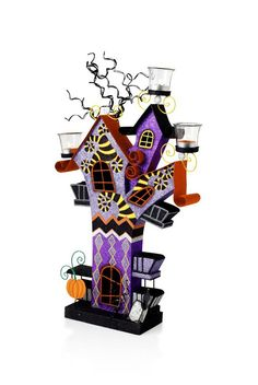 Pier 1 Haunted House Tealight Holder is glitter-saturated in purple, orange, yellow and black