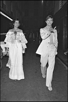 Bianca Jagger and David Bowie leaving a party in Paris