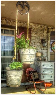Vintage cast iron pulley is a perfect flower pot holder and bucket of fun!
