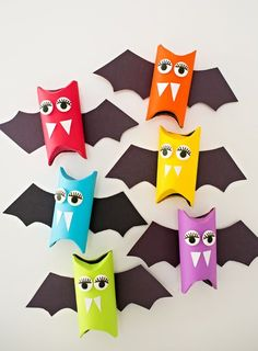 Rainbow Paper Tube Bats. Cute Halloween craft for kids. Make these as Halloween favors or colorful decorations!