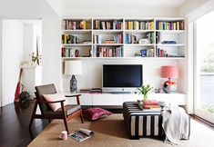 Not usually keen on anything near the TV (too much clutter - harder to focus on just a movie!) but love these bookshelves. Add to that the 50's occasional chair & striped ottoman - great pairing!