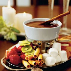 """""""Chocolate Fondue: When it comes to dipping, you're only limited by your imagination. You might even consider dunking croissants and French toast for breakfast."""" Slide 11 of 77 of """"Wickedly Delicious Chocolate Desserts."""""""