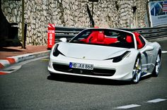 White Ferrari with red interior