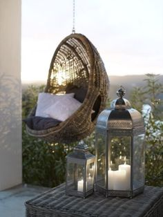 hanging egg chair and lanterns for the garden