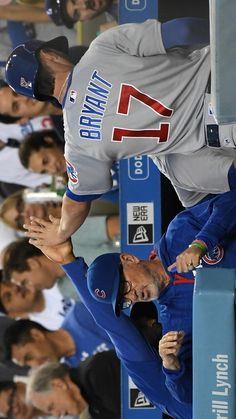 Kris Bryant is greeted in the dugout after scoring a run in the first inning Friday, Aug. 26, 2016, in Los Angeles. (Jayne Kamin-Oncea / Getty Images)