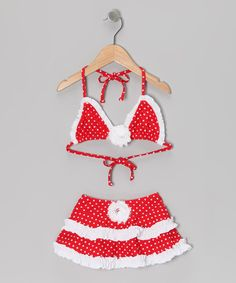Aruffly rose adorns the top and bottom of this bright and bold bikini. With stretchy frill-trimmed bottoms and adjustable ties on the top, this pairing is sure to make splash with a bathing beauty.Includes top and bottoms80% polyamide / 20% elastaneHand washMade in the USA