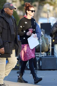 On set: Julia Roberts, 50, clutched onto a script and a healthy juice ahead of another busy day of filming for the drama Ben Is Back in New York on Wednesday
