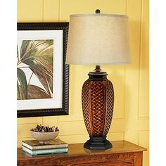 Faux wicker weaving topped by a beige linen shade lends island style to this classic table lamp.