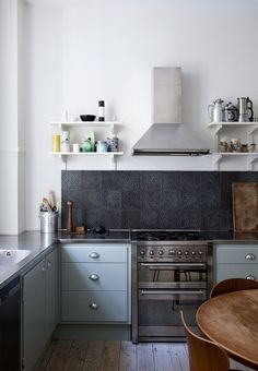 In my last kitchen trends post I noted a move towards open shelving, and now I'm starting to see more and more kitchens with little to no storage above waist height at all. This means more room for windows, a lighter, more open kitchen — and also the rise of the range hood, suddenly a prominent feature.