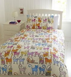 Colorful cats bedspread-- love this as an extra set of sheets for an aero bed or something