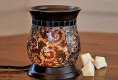 ScentGlow (you can melt wax cubes or use fragrance oil) {the whole house}  My most FAVORITE ScentGlow Warmer! The pic does not do it justice! I love the fact that all PartyLite warmer are made with LED light bulbs that are guaranteed to never burn out and don't get HOT so they are safe for delicate hands and surfaces! cassiprice@gmail.com for more info on PartyLite!