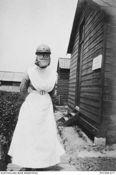 Sister Minnie Hough posing in a gas mask at Mobile Surgical Hospital No 1. The hospital was established by Mrs Mary Borden-Turner, to operate in the French section of the lines on the Western Front. In 1917-18 she employed, through the Australian Red Cross, four Australians to nurse wounded French soldiers at her hospital, known in French as Hopital Chirurgical Mobile No. 1. These were Sisters Hilda Loxton, Minnie Hough, Wallace, and Lynette Crozier who volunteered for service in France.