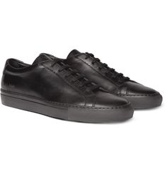 Fans return to <a href='http://www.mrporter.com/mens/Designers/Common_Projects'>Common Projects</a> for the brand's clean, minimalist style and superior construction, both of which are demonstrated by these black leather 'Original Achilles' sneakers. The design is one of the label's most popular, and has no detailing, save for the sleek signature golden stamp on the heels.