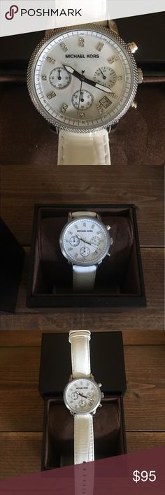 Women's Michael Kors Watch Three chronograph subdials track minutes, seconds, and hours on a 24-hour scale. Its croc-style white leather band has a buckle that holds the polished case securely to your wrist. Inside, a mother-of-pearl dial radiates more eye-catching whiteness while a textured bezel adds additional style.  This watch comes with original box and instructions and is in EXCELLENT condition. Looks BRAND NEW. Works like a charm just needs a new battery. KORS Michael Kors…