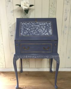 This petite Queen Anne-style bureau has been hand painted in ASCP Old Violet over Old White - original leather writing oval in Chateau Grey - and highlighted with Gold Rub 'n Buff; the lid panel is decorated in Old White using a stencil from the Annie Sloan range; it has then been lightly distressed to bring out the detail, and sealed with Annie's soft clear wax to give a smooth but rustic finish.   https://www.facebook.com/pages/Orchard-Cottage/1529530540621012
