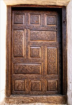Door in Khiva, Uzbekistan. This pattern symbolizes the solar system the planets in it, and the eternity of the Universe