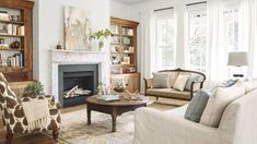 A mix of vintage and catalog finds lends a casual vibe in this Georgia farmhouse'sliving room, where pine bookcases, rescued from a demolished elementary school, keep company with a new linen sofa. An abstract painting by artist —andCLGeneral Store vendor—Deann Hebertadds texture above the chippy mantel.