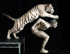 Lennette Newell has created a bizarre exhibit featuring models being covered with body paint to look just like wild animals