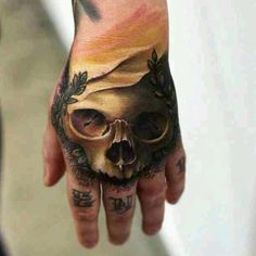 Skull sunset tattoo, hand ink