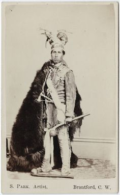 Iroquois man - If anyone can identify him, please email me. Gregory Schaaf, Ph.D. historian, Indians@nets.com. Thank you.
