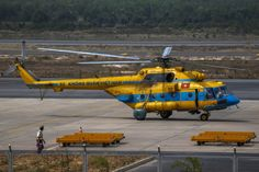A Vietnamese helicopter taxies at Phu Quoc Airport before being utilised in the mission to find the Malaysia Airlines flight MH370 in Phu Quoc Island, March 11, 2014. — Reuters pic